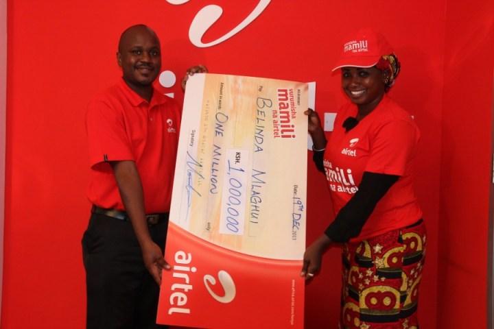 Belinda Mkacharo receives her dummy cheque