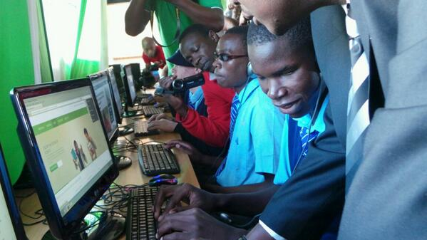 Thika School For The Blind's Nelson Otieno, accessing Safaricom's new site as Nzioka Waita looks on