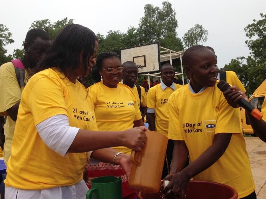 UNICEF Lifeskills Specialist DR. THELMA MAJELA  and Ministry of Health Director Ms Lujanga _help student Lillian Andrew demonstrate proper handwashing