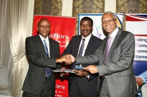 Jamii Bora CEO Mr. Samuel Kimani, Kenya Power MD Dr. Ben Chumo and Rapid Communication CEO Mr. Anwar Majid Hussein