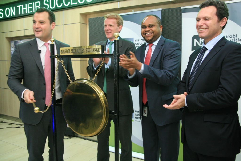 (Left-Right) Carl Esprey CEO Atlas Development & Support Services (ADSS), Rings the Gong to mark the beginning of trading of Atlas shares at the Nairobi Securities Exchange. With him is Edward Burbidge CEO Burbidge Capital, Andrew Wachira Acting CEO NSE and Lachlan Monro Chief Operating Officer ADSS.