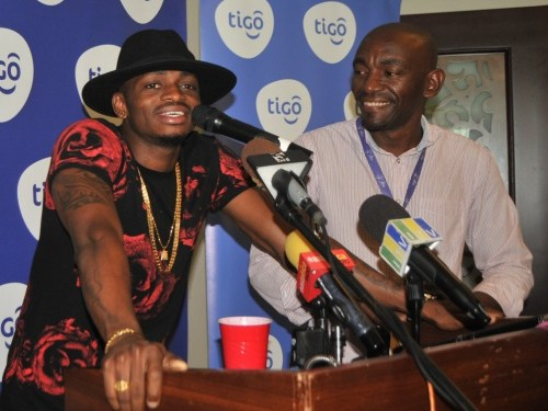 Award-winning vocalist Diamond Platnumz (left) shares his excitement for Tigo Music; the country's first mobile app that provides Tanzanians with unlimited access to music. To his left, Tigo Brand Manager, William Mpinga, during the press launch yesterday in Dar es Salaam.