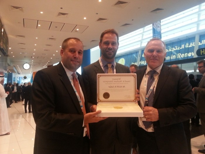 From Left to right: M-KOPA Solar Executive Chairman Nick Hughes with Jesse Moore Managing Director, and Chad Larson, Finance Director display the award certificate after winning in the SME Category of Zayed Future Energy Prize 2015.