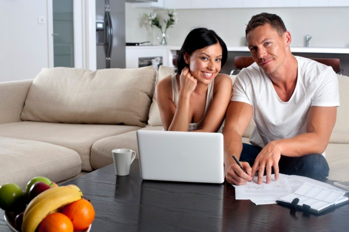 Couple doing paperwork with a laptop