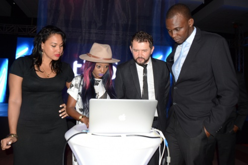 (From Left: Tanzanian Socialite Abby Platjes and Musician Vanessa Mdee getting schooled on how 4G LTE technology works by Tigo representatives)