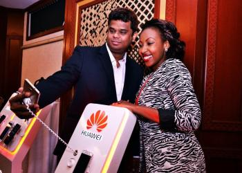 Dharmaraj Diwakar (left) Huawei Sales Director takes a selfie with Mwalimu Rachel of Homeboyz Radio during the launch of four new Huawei phones at Serena Hotel on 1st September.