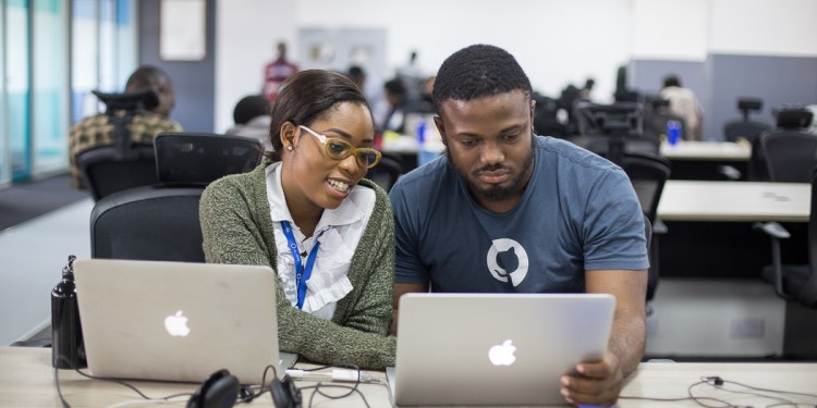 Two of the 1000 Andela developers working out of the Lagos office