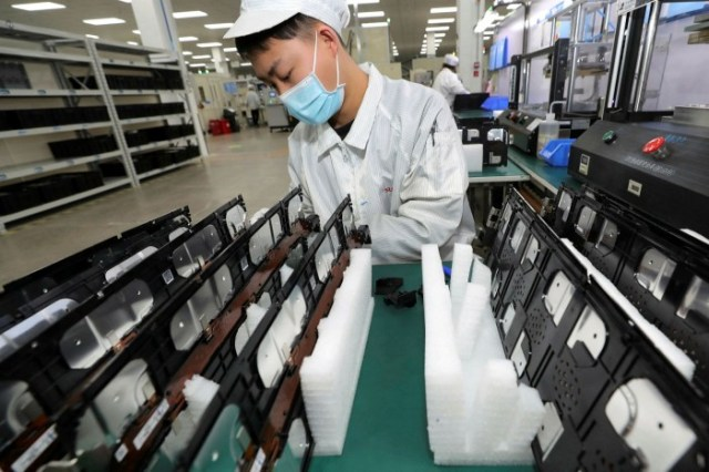 A factory worker for Xinwangda Electric Vehicle Battery Co, which makes lithium batteries for electric cars and other uses, in Nanjing in China's eastern Jiangsu province