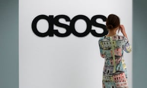 A model walks on an in-house catwalk at the ASOS headquarters in London in 2014.
