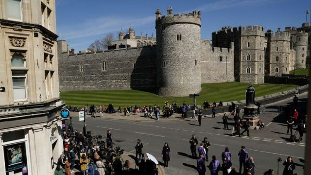 People gather ahead of the funeral of Prince Philip in Windsor. Pic: AP