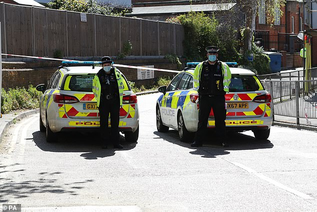 Police at the scene in Walton-on-Thames this week as investigations into the suspected murder continued