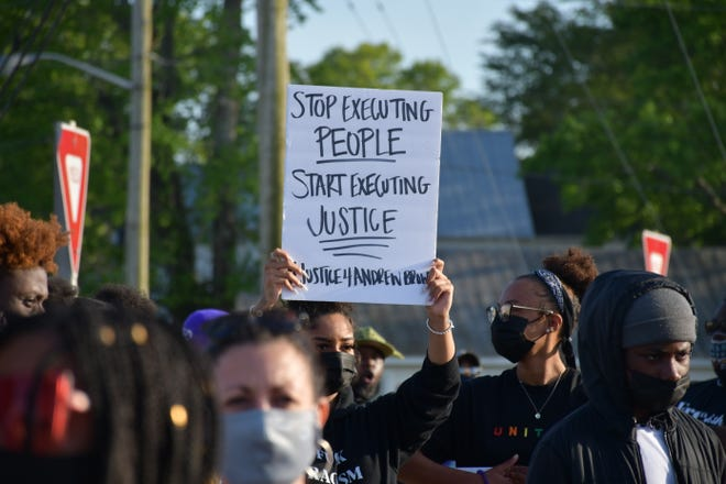 Demonstrators gather in Elizabeth City, N.C., on Tuesday to demand accountability and justice after sheriff's deputies fatally shot Andrew Brown Jr. last week.