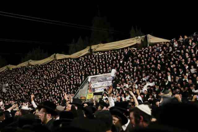 Jewish worshippers sing and dance on temporary seating at the Lag Baomer event in Mount Meron, northern Israel.
