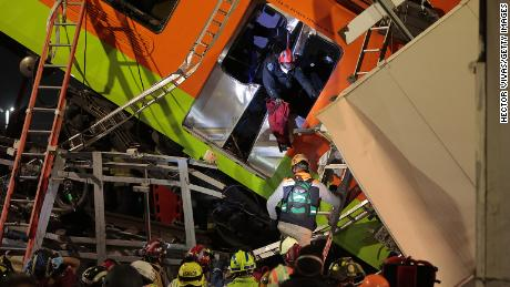 Emergency personnel search for accident survivors after a raised subway track collapsed on May 3 in Mexico City.