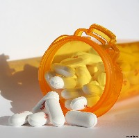 Pills in a prescription bottle (Photos8.com)