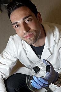 Daniel Hashim with samples of nanotube sponges (Rice University)