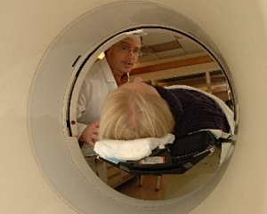 Patient enters a PET scanner (National Institute of Mental Health)