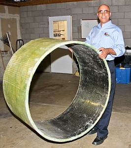 Mo Ehsani holds a section of lightweight pipe. (University of Arizona)