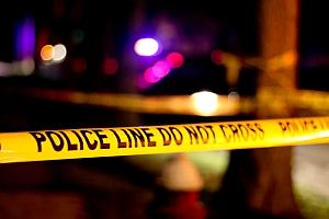 Police crime scene tape (Michael Melchiorre/Flickr)