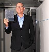 Sharone Zehavi, Scifiniti CEO, holding a SmartWafer