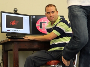 Dan Goble tests the B-trackS concussion testing system