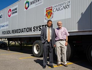 Gopal Achari, left, and Cooper Langford in front of their mobile PCB clean-up unit (Riley Brandt, University of Calgary)