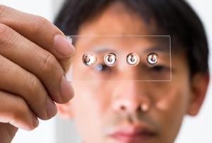 Slide with four droplet lenses