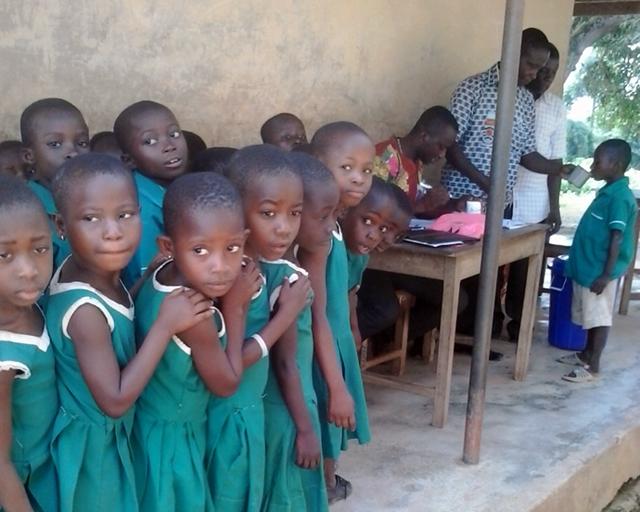 Children receiving vaccine