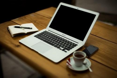 Laptop, coffee