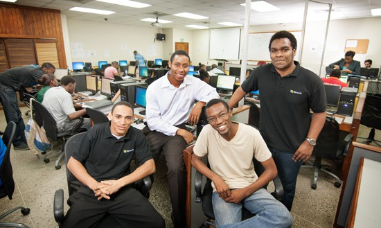 The winning USC team in the university's computer lab; from left, Kyrone Smith, Christopher Adolph, Akel Nickles and Chika Ibneme. Photograph by Mark Lyndersay.