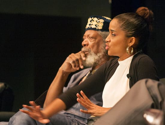 """LeRoy Clarke and Camille Selvon-Abrahams respond to questions from the audience at """"The Human Imagination at Work,"""" a panel discussion on November 18 hosted by the Ministry of Planning and Sustainable Development. Photograph by Mark Lyndersay."""