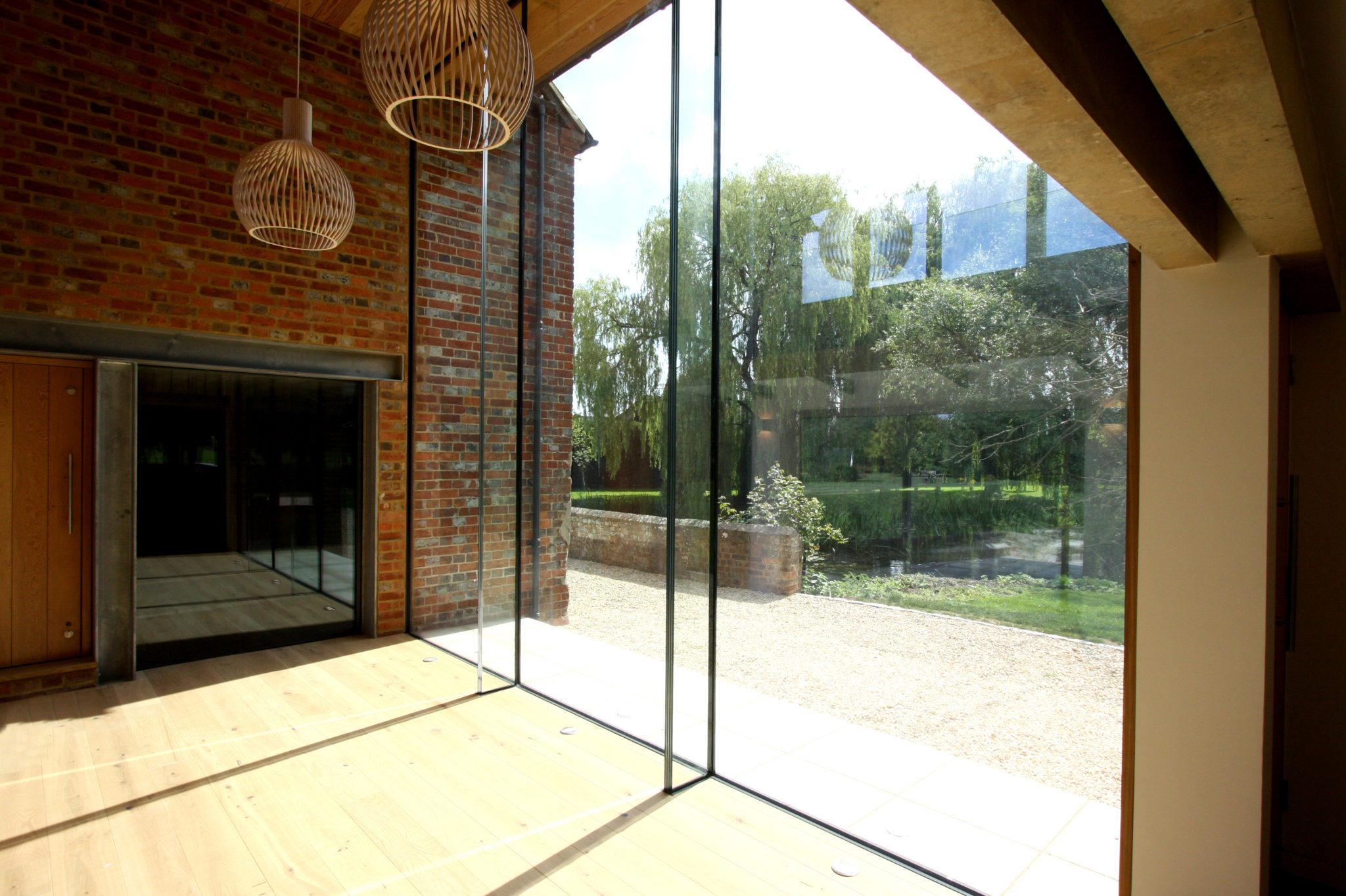 glass fins to tall glass wall