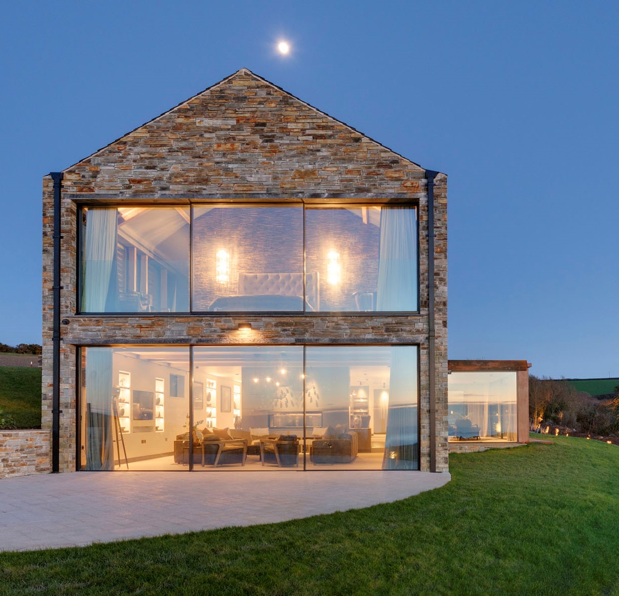 Structural glazed facade to coast home