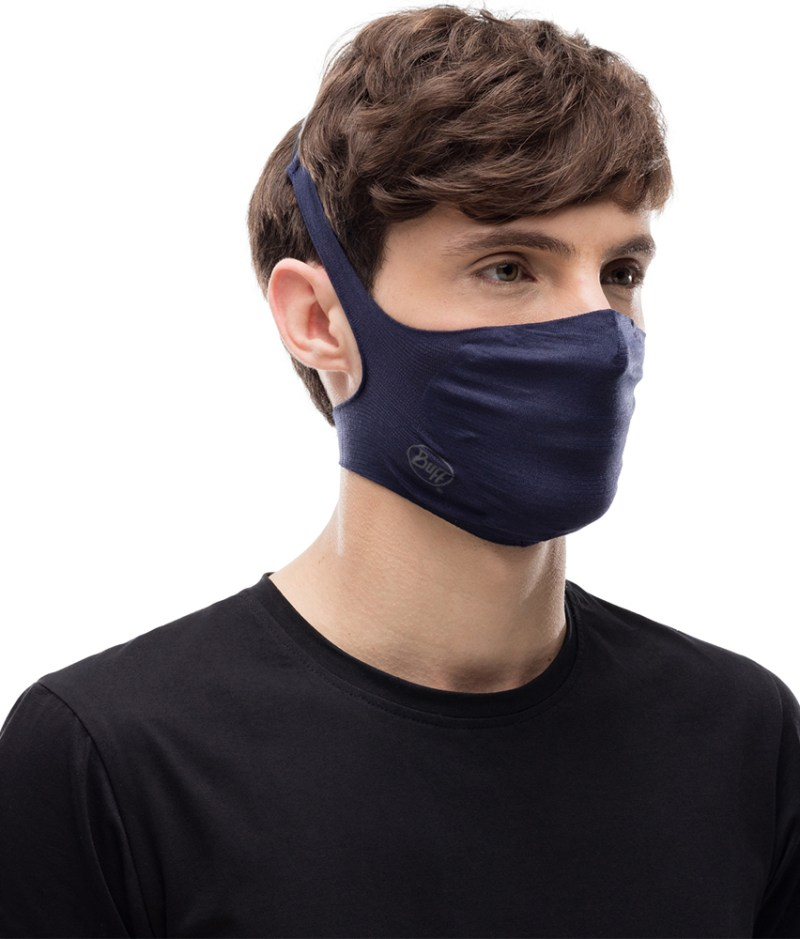 "Studio photo of BUFF® Filter Mask Design ""Solid Night Blue"" worn by a woman. Source: buff.eu"