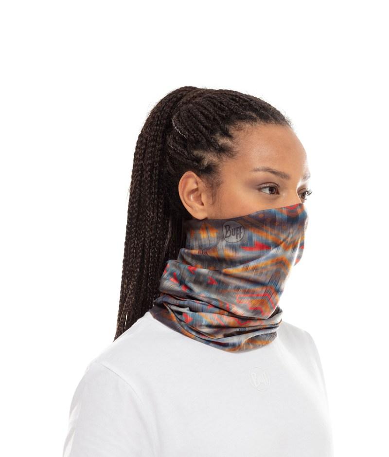 "Studio photo of a Woman wearing the BUFF® Coolnet UV+ Design ""Wild Multi"". Source: buff.eu"