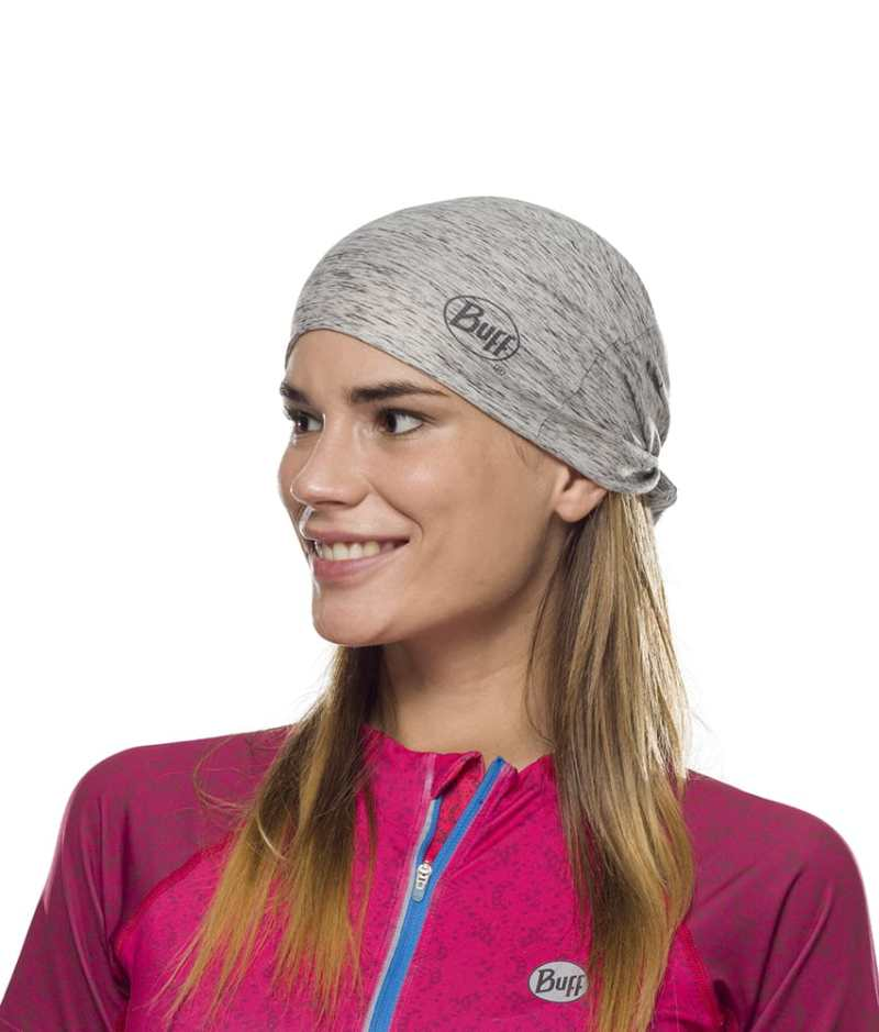 "Studio photo of a Woman wearing the BUFF® Coolnet UV+ Design ""Silver Grey HTR"" as a hat. Source: buff.eu"