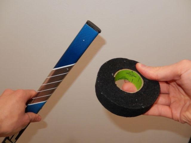 Bâton de hockey et tape
