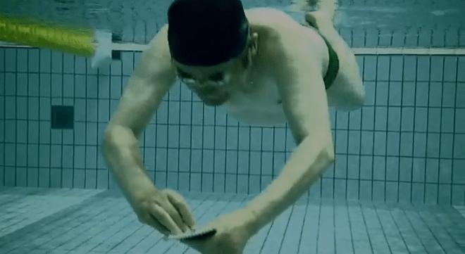 Yoshiro Nakamatsu writing underwater