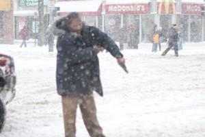 cop bring gun to a snowball fight