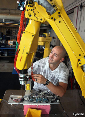 Dude building a robot