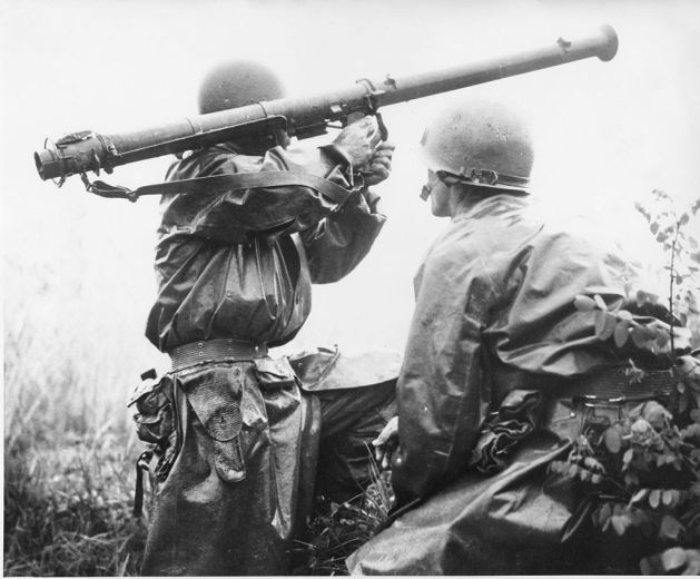 Moments before his death, Shadrick (right) looks on as another soldier fires a bazooka.