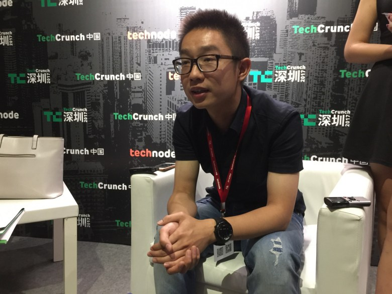 Austin Zhang answering questions backstage
