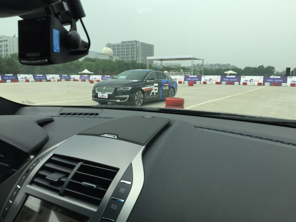 Passing the other Lincoln MKZ running Apollo 1.0—a world first having two autonomous cars on the same track (Image credit: TechNode)