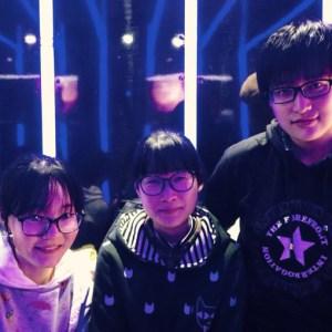 Three high school girls in VR arcade