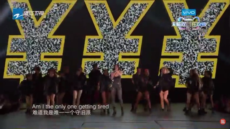 """British singer Jessie J singing """"It's not about the money"""" without a hint of irony during the performance od her hit single """"Price Tag"""" during 2017 Singles Day gala organized by Alibaba. Screenshot from YouTube."""