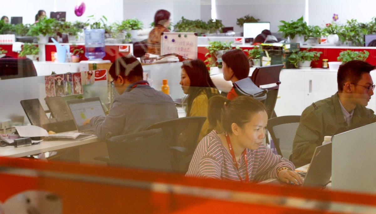 Office workers & computers at Chinese internet company 996