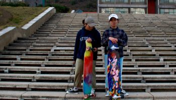 University students, pictured here December 2018, skateboard near Guiyang, Guizhou outside the Guizhou Normal University library. (Image credit: TechNode/Cassidy McDonald)