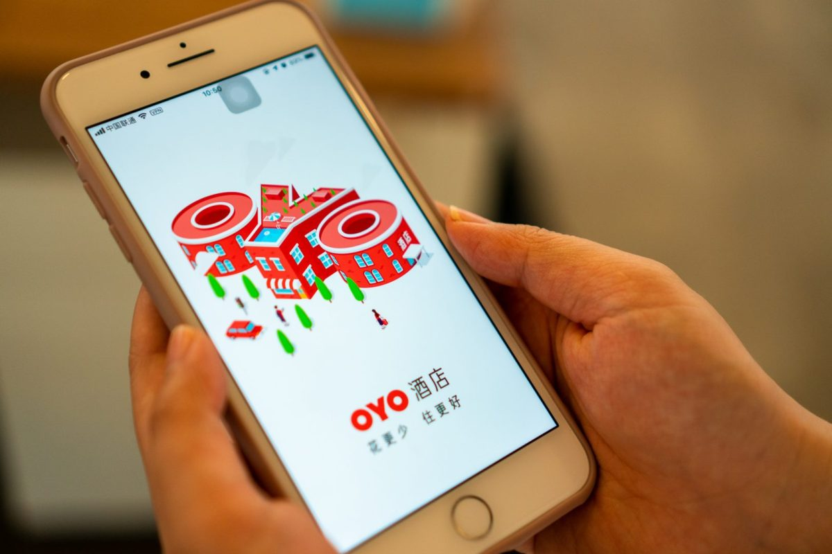Oyo A user opens OYO's app on an iPhone. (Image credit: TechNode/Eugene Tang)