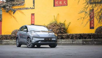 A Xpeng G3 2020 model is parked outside Wenshu Temple in the southwestern city of Chengdu. (Image credit: Xpeng Motors)