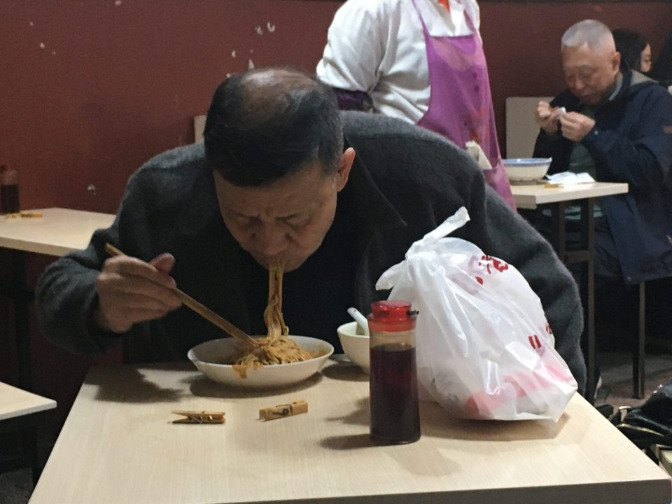Nobody's told this happy noodle eater in Shanghai that they get all their food from grocery delivery.
